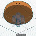 Figure 8-26. Les trous sont maintenant alignés verticalement avec le bouton.